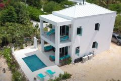 Drone shot of Gracehavn Villa in teh Bight Settlement , Providenciales