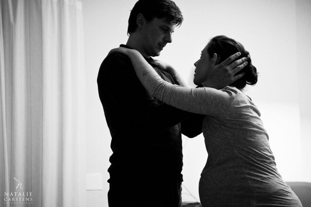 husband supporting wife during labor - Natalie Carstens Birth Photographer