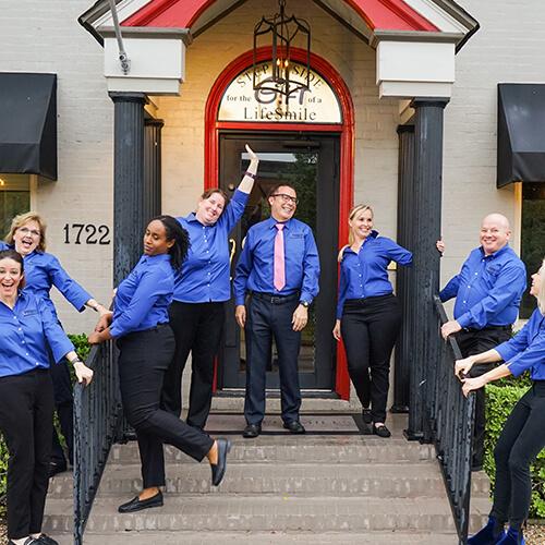 The team at Life Smiles posing outside their Houston, TX dental practice