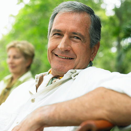 Older man relaxing and smiling after receiving dental implant in Houston at LifeSmiles
