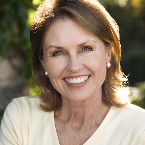 Older lady who is able to smile due to the affects of Botox