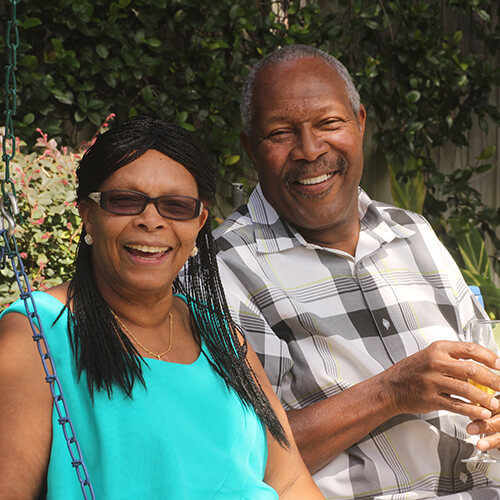 Phillip enjoying a glass of champagne with his wife after his full mouth reconstruction
