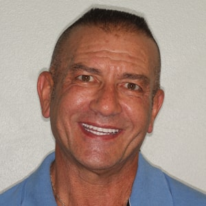 Stece C., an actual patient of Dr. Mitchmore, your Houston dentist, after his smile transformation