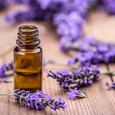 Calming lavender and an empty aroma bottle designed to release a calming smell