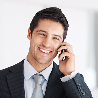 Man wearing a suit and speaking on the phone