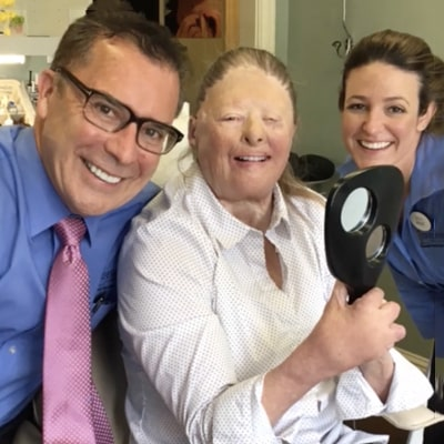 Dr. Mitchmore, your Houston dentist, smiling with Candace an actual patient who received a stunning smile transformation.