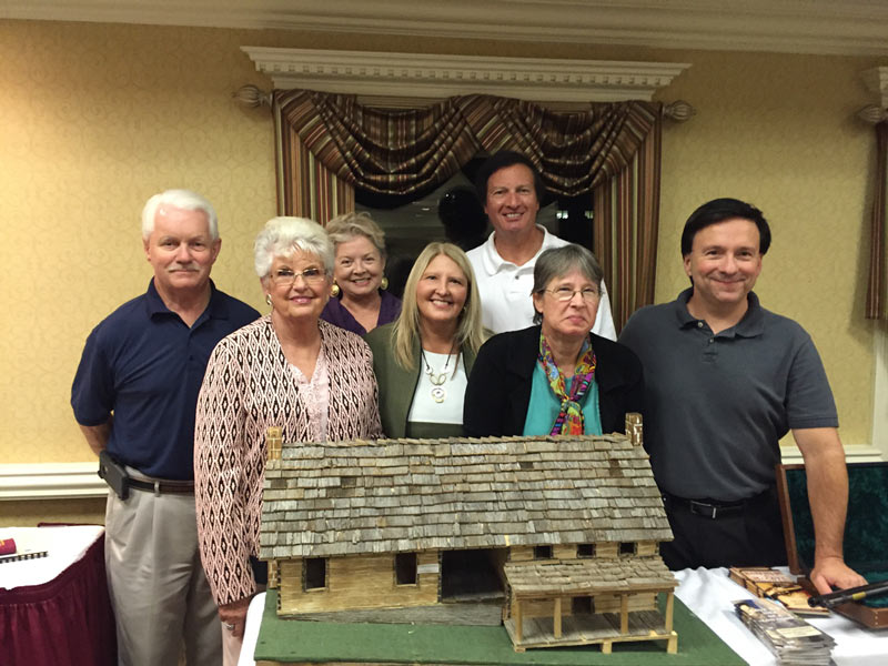 Hatfields & McCoys with community members around McCoy Cabin model
