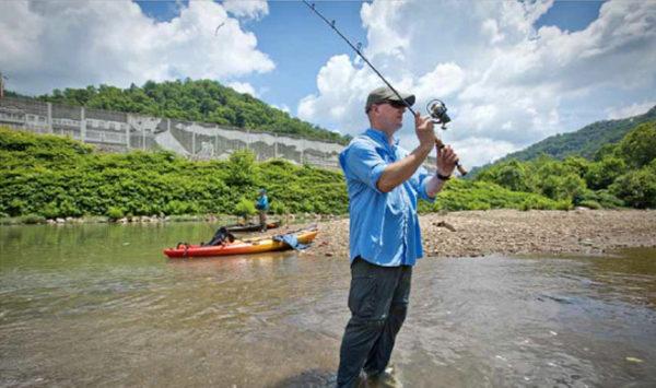 Man Fishing the Tug