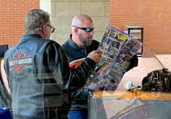 Motorcyclists looking at a tour map.
