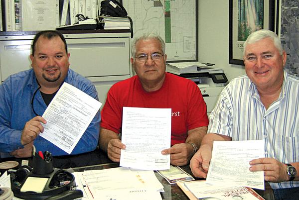 Commissioners John Betancourt Pl. 1, John Hernandez Pl 2 and Mayor Steve Brewer