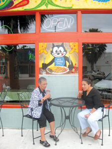 Jane Lozano and Tina Alejandro enjoy a brief respite at one of the outdoor tables