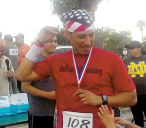 Jesse Robles, 1st place, 30-39 age group, has participated in the event for 10 years.  Jesse is a founding member of RuNsane Running.  He invites anyone who is interested in running to follow RuNsane Running on Facebook and join the team.