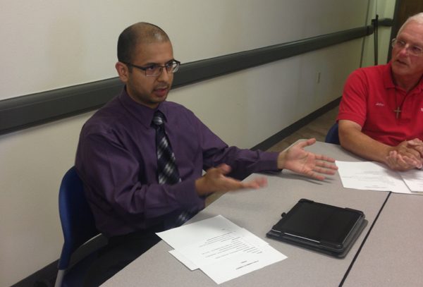 State Farm Agent and Chamber member John Ftacek listens as Marco Jilpas (left) shares information about the type of legal assistance he can offer La Feria residents. Photo: LFN
