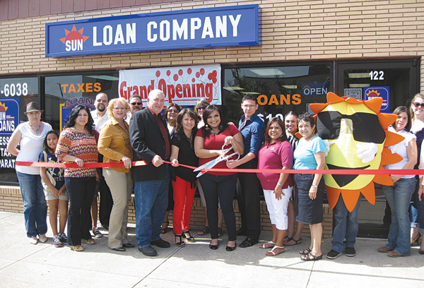 Sun Loan Company Area Supervisor Brenda Blanco (center) cuts the ribbon to officially open the new La Feria location on Commercial Avenue across the street from city hall. Also holding the ribbon for the event is (l-r) Maria Chavero, Mayor Pro-Tem Lori Weaver, Mayor Steve Brewer, La Feria Office Manager Lidia Hernandez, Brenda Blanco, La Feria Assistant Manager Jose Sanchez and Floating Manager Adriana Vega. Photo: Bill Keltner/LFN