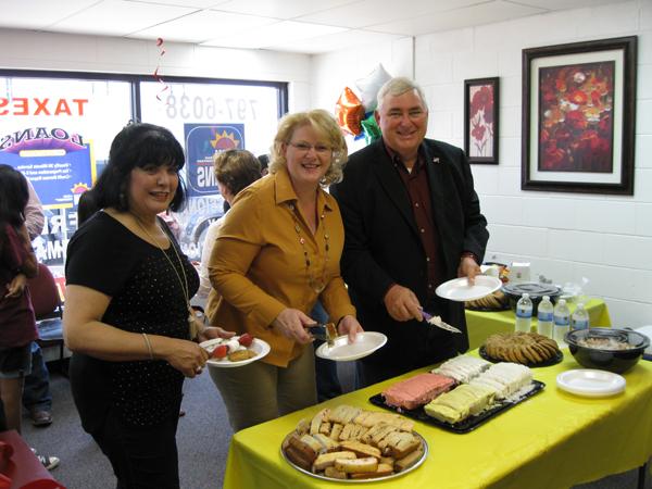 City Secretary Olga Oberwetter, Mayor Pro-Tem Lori Weaver and Mayor Steve Brewer enjoy the sweets and treats.