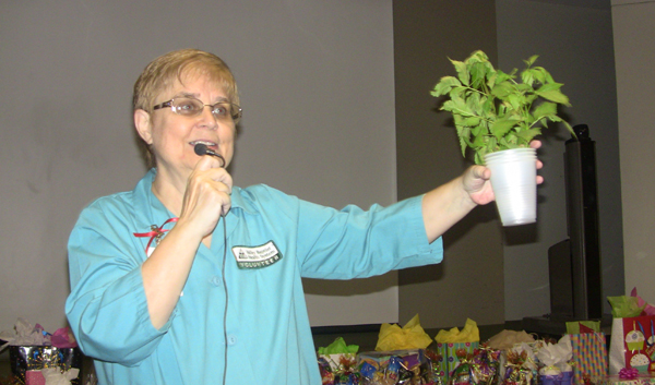 """BRINGING  HOPE & CHEER  TO STROKE SURVIVORS - Debbie Diehl, founder of a H.O.P.E. Stroke Support Group, gives out a prize during a special """"Un-Birthday Party"""" for stroke survivors and family members which was held recently at Valley Baptist Medical Center in Harlingen."""