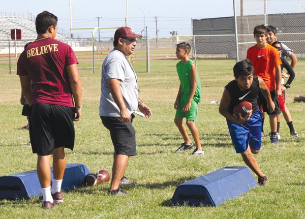 LFHS Coach Pete Martinez help the boys during a skills drill.
