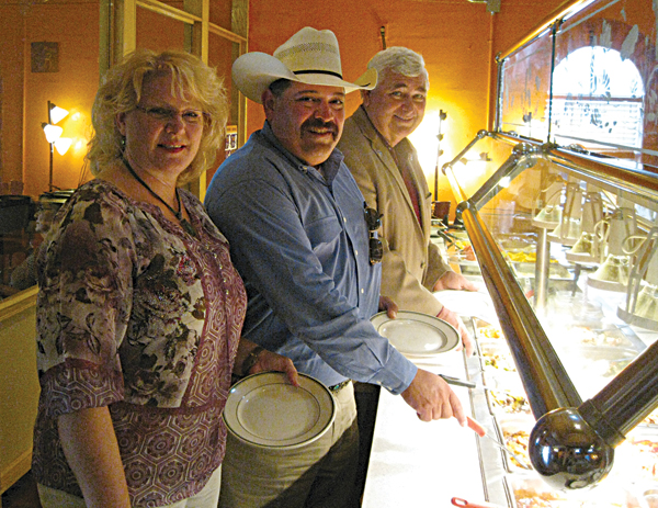 Lori Weaver, Judge Mike Trejo and Mayor Steve Brewer accept Angie's invitation to sample her buffet.