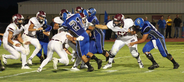 The Lion defense swarms in on the Gator.
