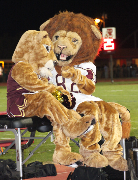 The Lion mascots taking a break from cheering for the Lions.