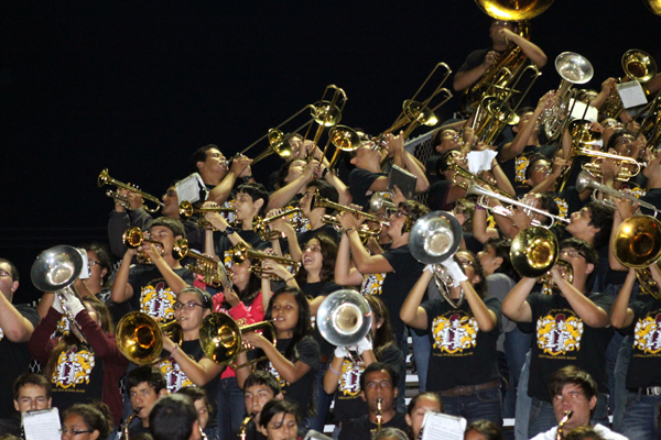 Above, The Lion band performs during a shortened game.