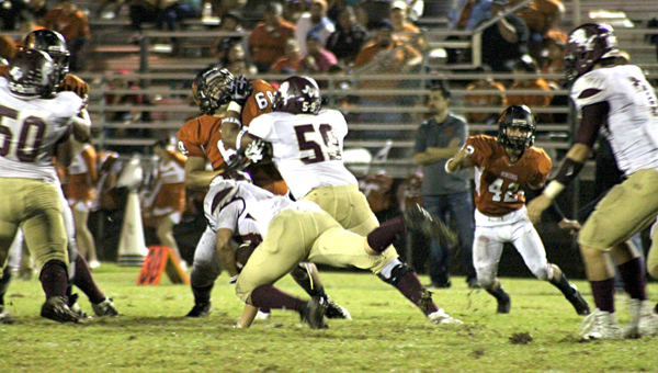 Andres Rosales blocks for the running back.