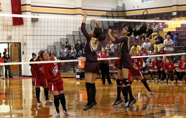 The Lionettes go up to block a shot.