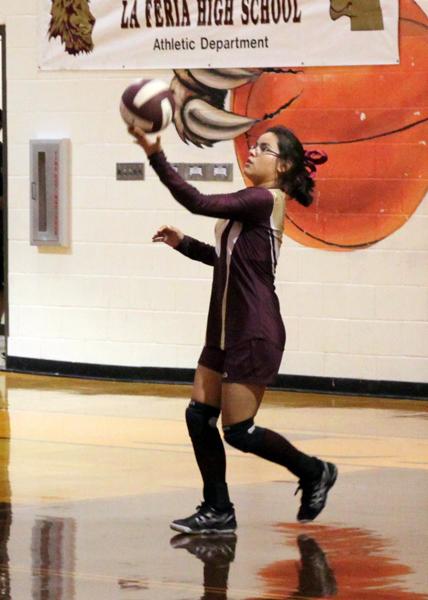 Annette Ruiz prepares to serve the ball.