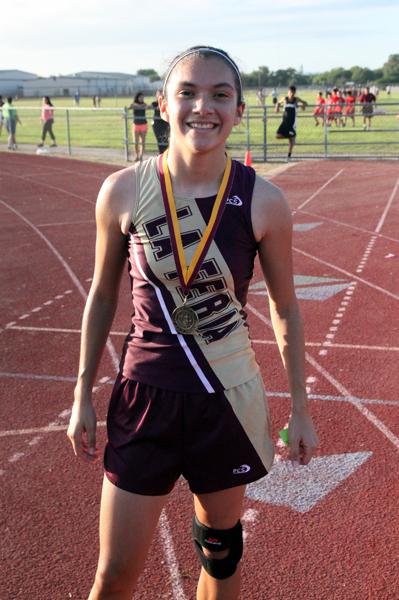 Kayla Olivarez wins the girls division Cross Country.