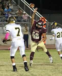 Jesse Leal attempts to block a pass.