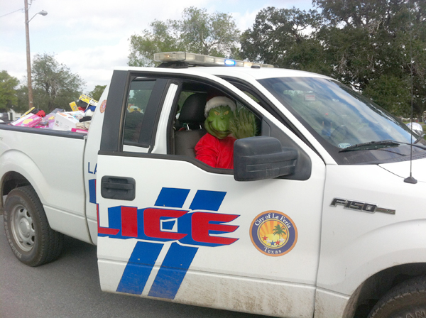 """Even """"The Grinch"""" got into the spirit of the season helping Santa deliver toys during Operation Smile."""