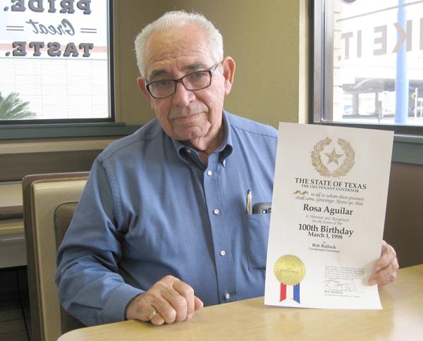 Tony Guevara shows Proclamation from Bob Bullock to Rosa Aguilar on 100th birthday.