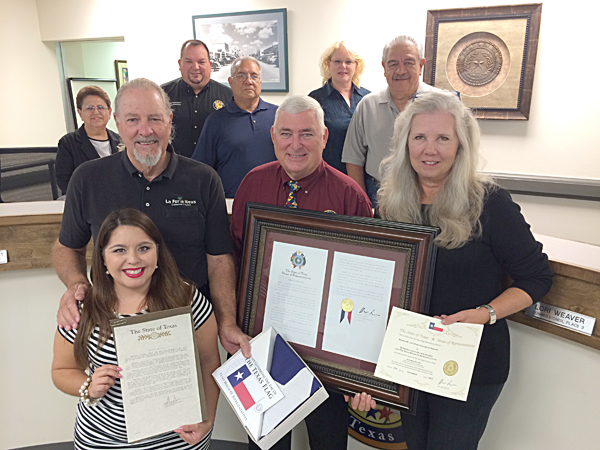 (l-r front) Michelle Villarreal, La Feria News Publisher Don Wright, Mayor Steve Brewer, La Feria News Editor Mary Beth Tankersley Wright and (l-r back) Commissioners Angelica Baldivia, John Betancourt, John Hernandez, Mayor Pro-Tem Lori Weaver and Victor Gonzalez, Jr.  Representative Longoria's office also presented a Texas flag that was flown over the State Capitol at Austin to the newspaper.
