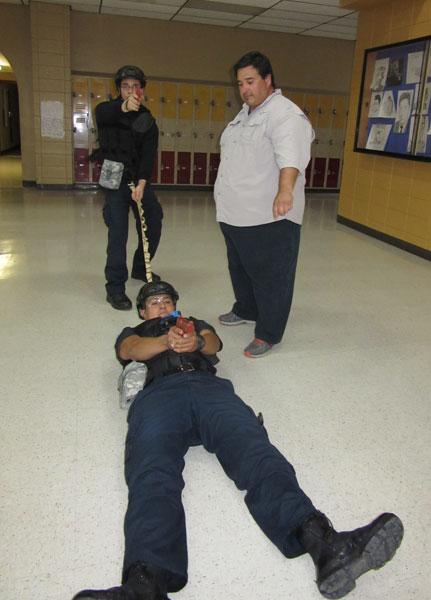 Method of extrication demonstration for fallen officer, Officer down:Armando Gonzalez, EMT;  2nd officer, Adam Cancino, La Feria; Instructor Joshua Alvardo.