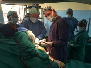 Dr. Chekka with the Operation Walk team