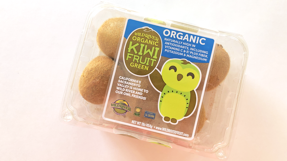 "Our Owl Friends and associated kiwi owl logos are trademarks of Wild River Marketing Inc. Designed by Ben Young Landis and Guy Rogers. The photo shows a plastic clamshell container with six kiwifruits inside. The container's graphic shows the smiling Wild River green kiwi owl with one wing waving. Graphic says ""California's Sacramento Valley is home to Wild River and Our Owl Friends!"" and that the fruits are organic, naturally high in antioxidants, including vitamins C & E! Plus fiber, potassium & magnesium!"