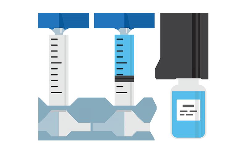 Two medical syringes and bottle of medicine