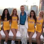 Jonny Blu poses with the Los Angeles Laker Girls (Downtown Los Angeles)