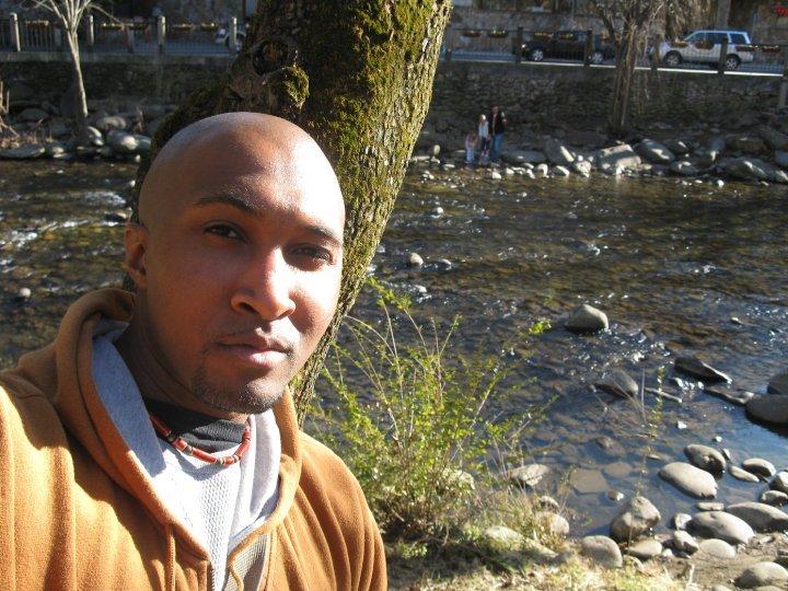 man next to brook