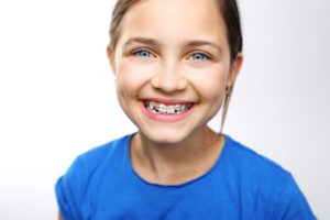 girl smiling with retainer