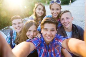 Group of friends taking selfie