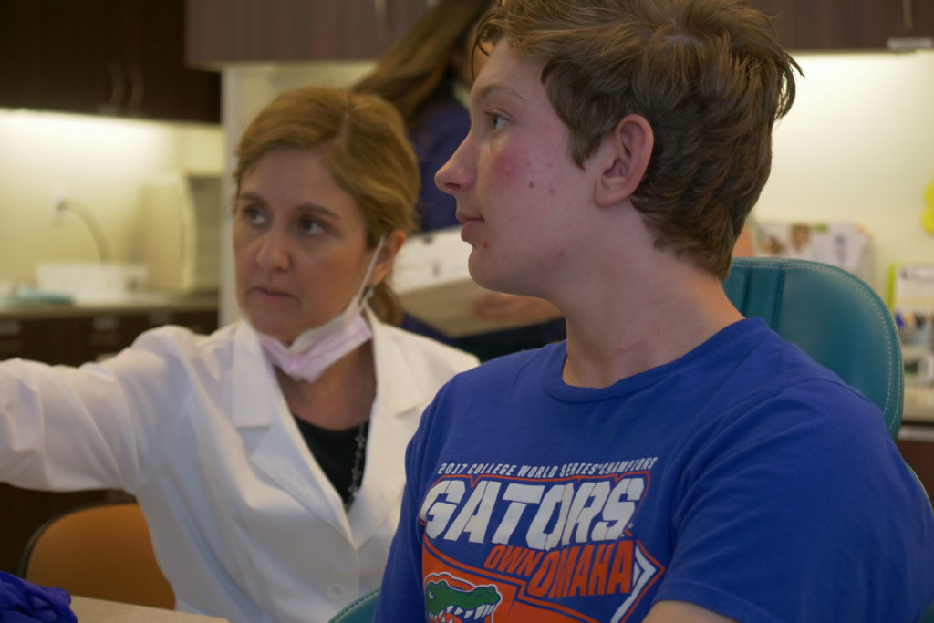 Dr. Adriana talking with a patient about treatment