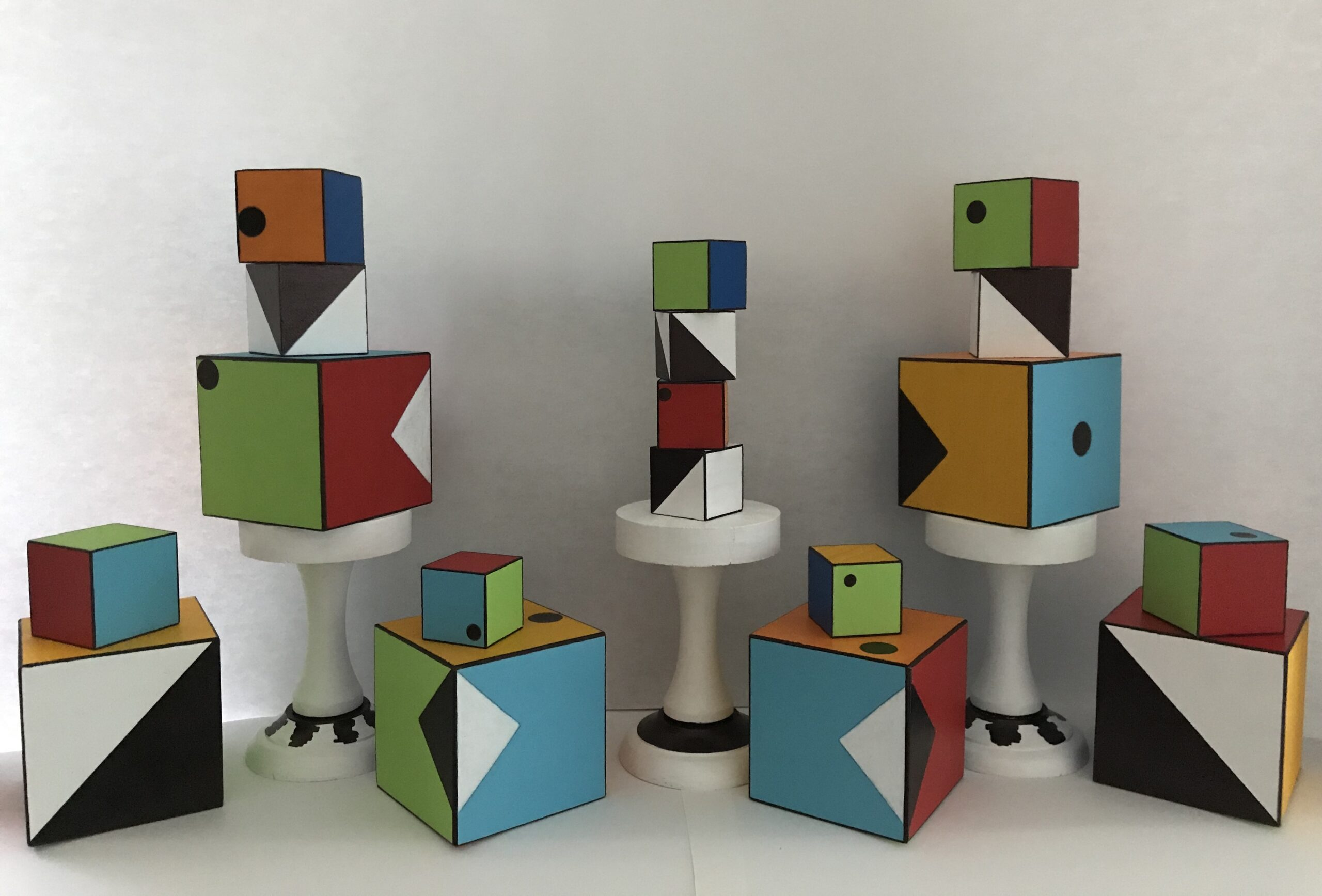 """""""Building Blocks of Life"""" by Lisa Collodoro, acrylic on wood, sizes range from 1.5 to 3.5 inches"""