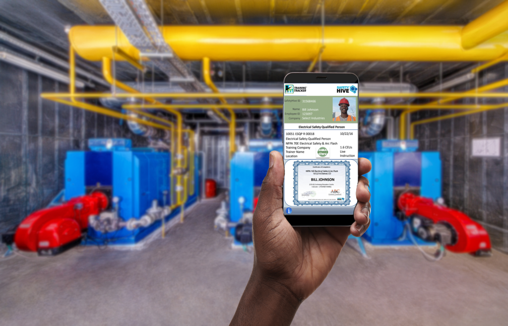 A first person view of a hand holding a phone. On the phone is the holder's certificate of training in electrical safety.