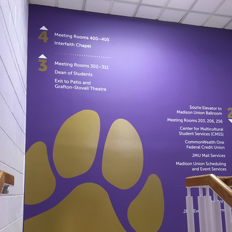 Madison Union stair landing directional signage