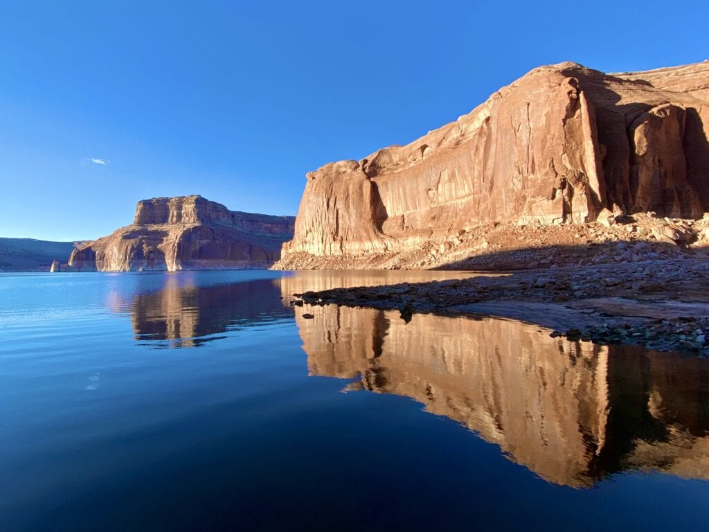 Reflections on Lake Powell traveling from Arizona to Utah by Houseboat