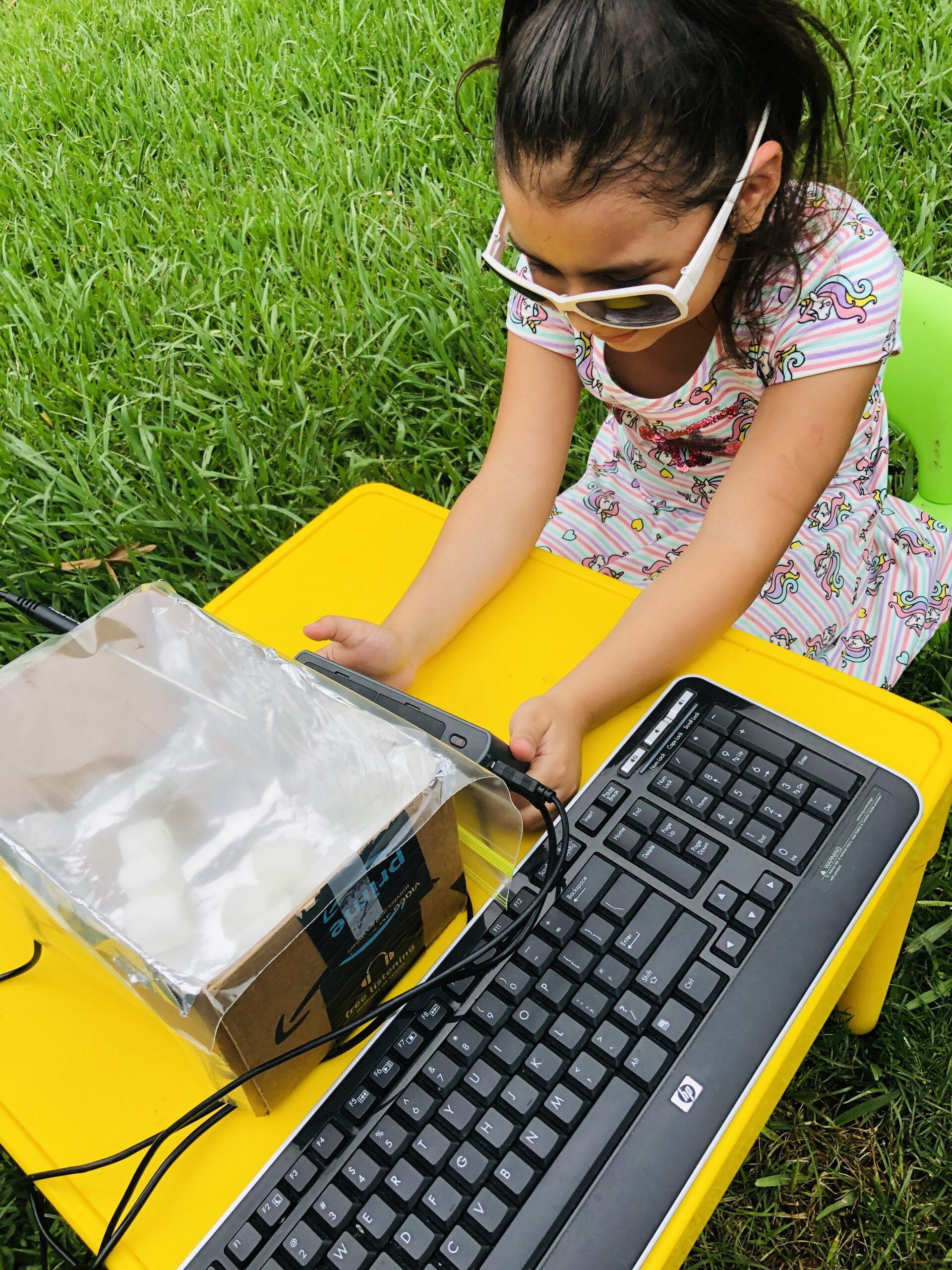 Student using Talking LabQuest in high contrast mode to review data from solar oven activity