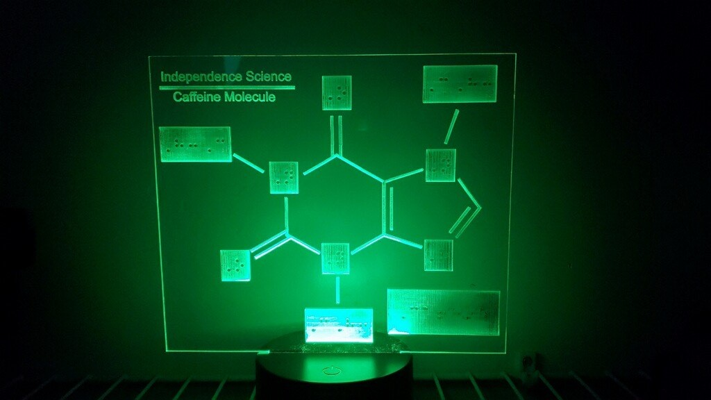 Caffeine molecule LED lamp with the color of the light set to green