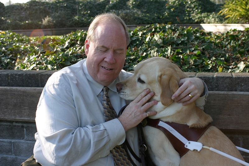 Michael Hingson with his dog guide, Roselle