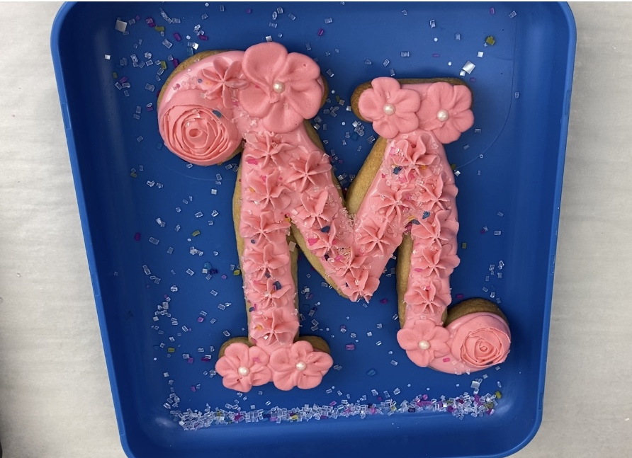 Add sprinkles on M for Mother's Day Flower Cookies